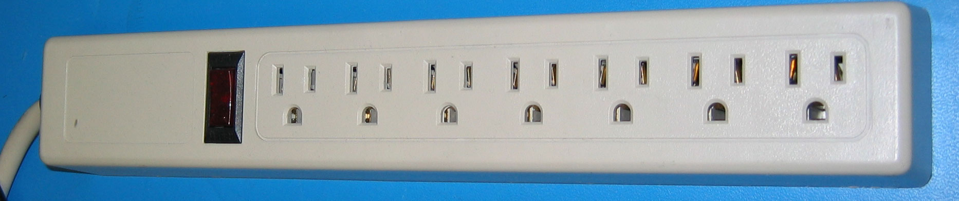 Image Credits: US-power-strip-rotated via Wikimedia Commons (Licensed under CC BY-SA 3.0)