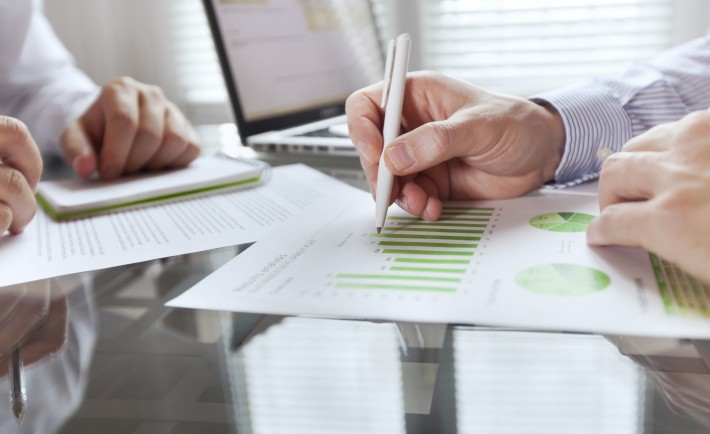 business monitoring, close up of hands of businessman