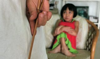 A child waiting to be caned