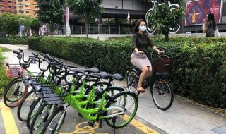 woman in mask cycling