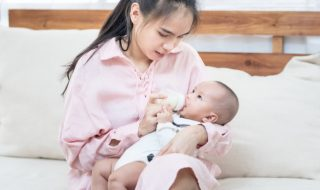 young-asian-mother-holding-newborn-baby