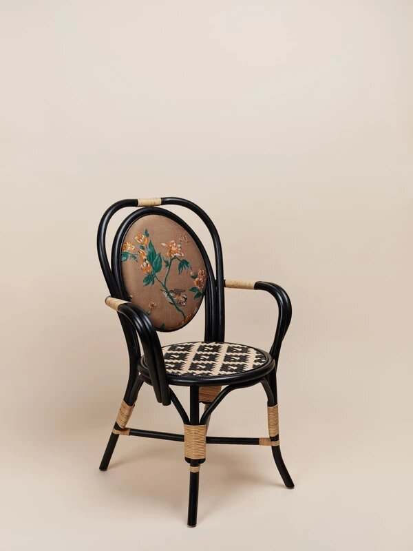 natural rattan dining chair in a black finish