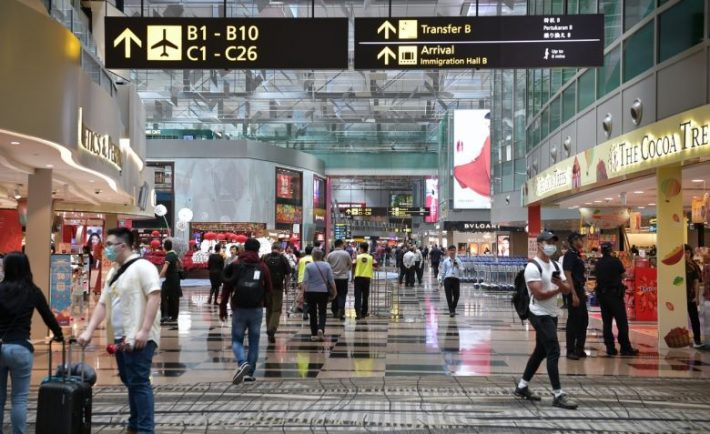Changi Airport with people in masks