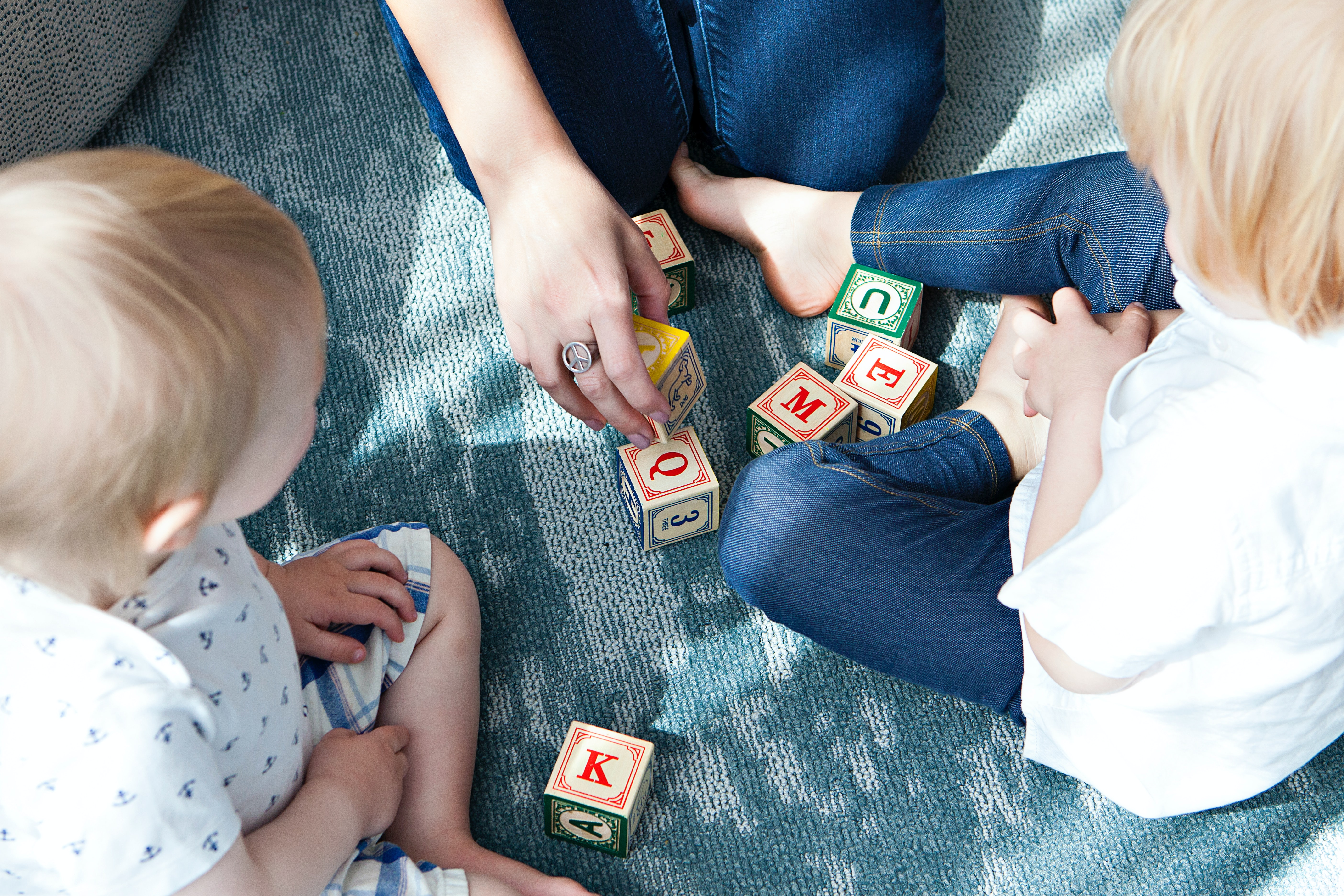 toddlers playing with letter cubes
