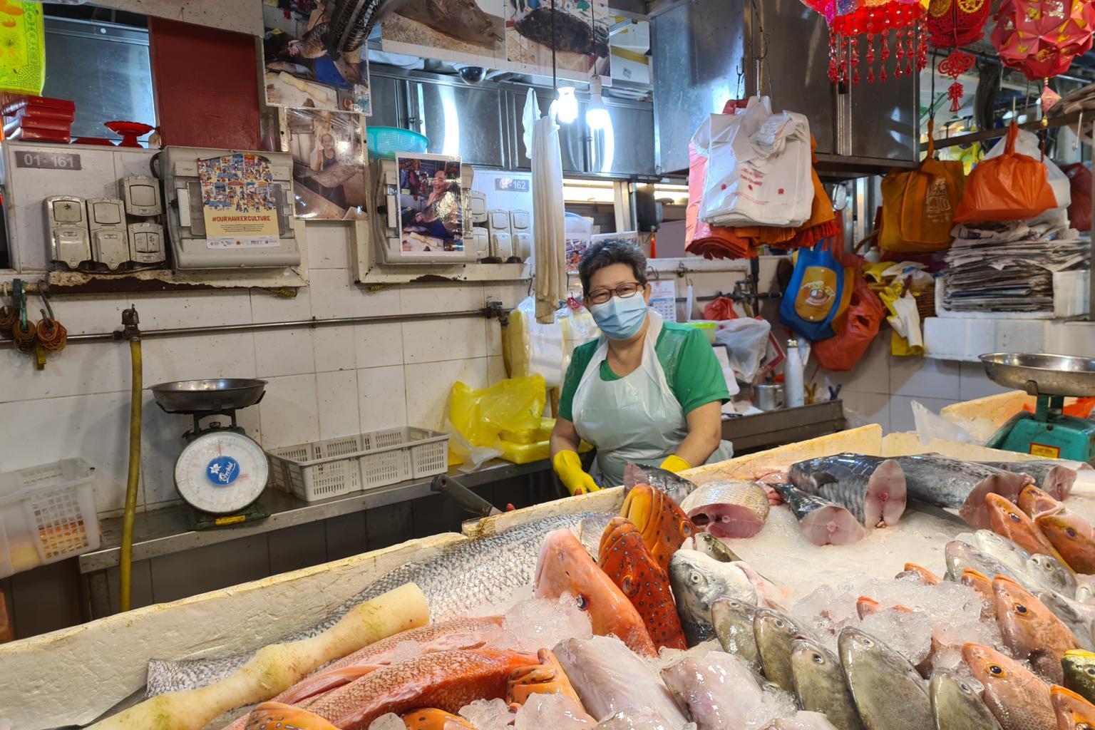a fishmonger at Ghim Moh Market & Food Centre