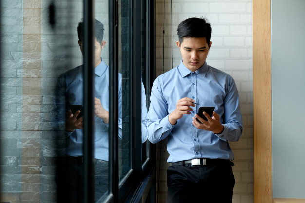 asian-man-using-mobile-phone