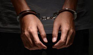 man in hand cuffs