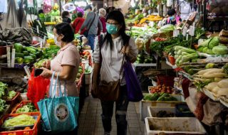 women shopping at a wet market