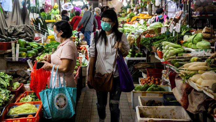 women shopping at a wet market