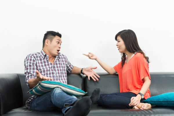 an asian couple arguing
