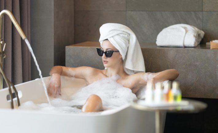 a lady soaking in a bathtub