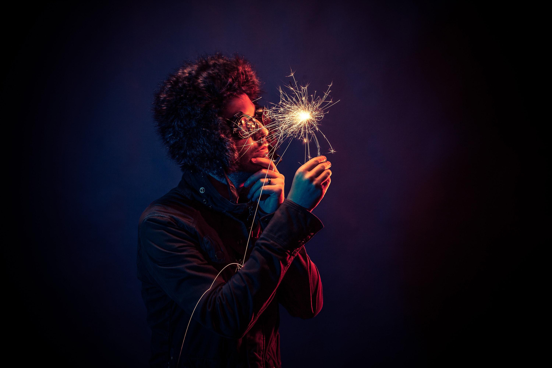 a man holding a sparkle