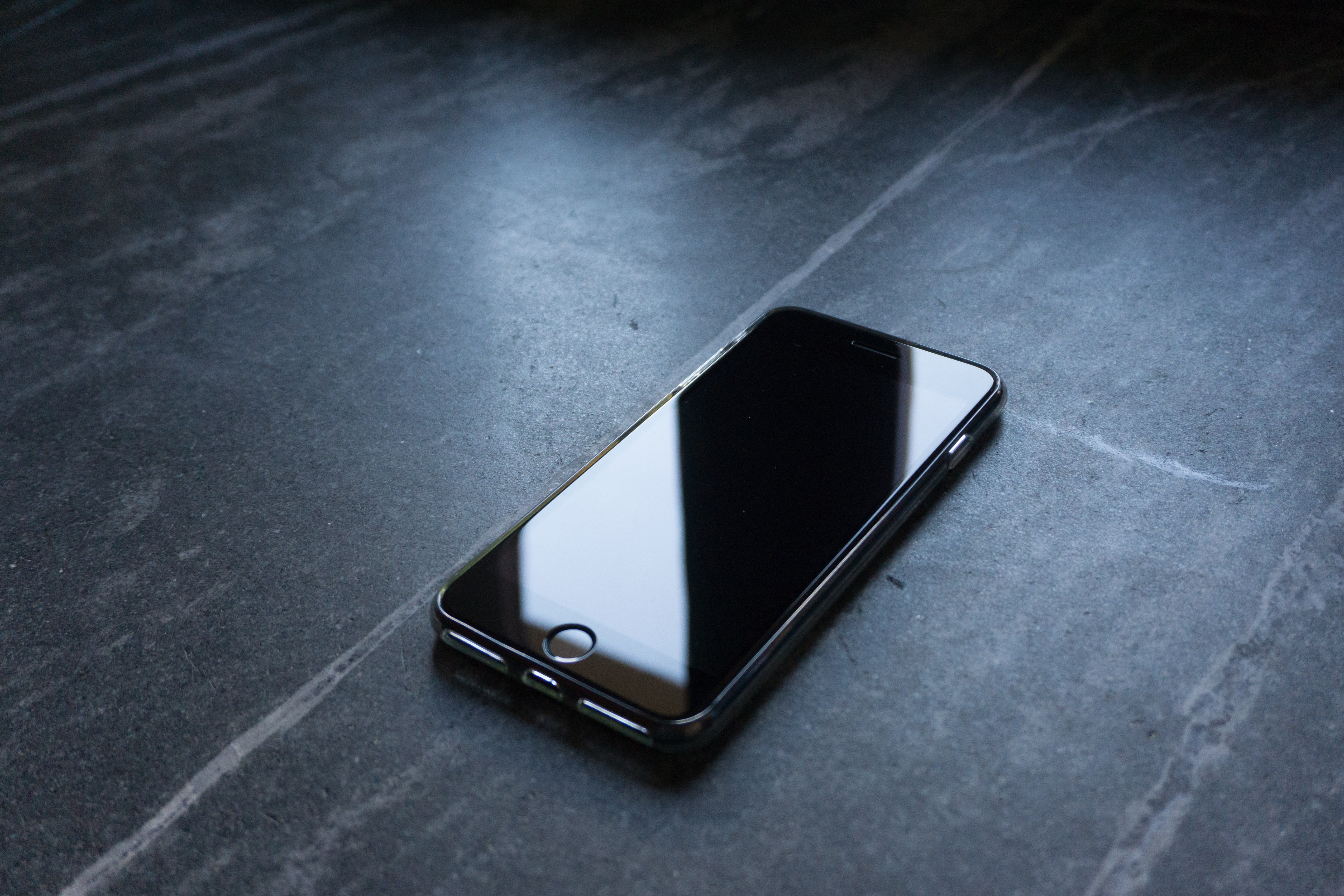 a mobile phone on the floor