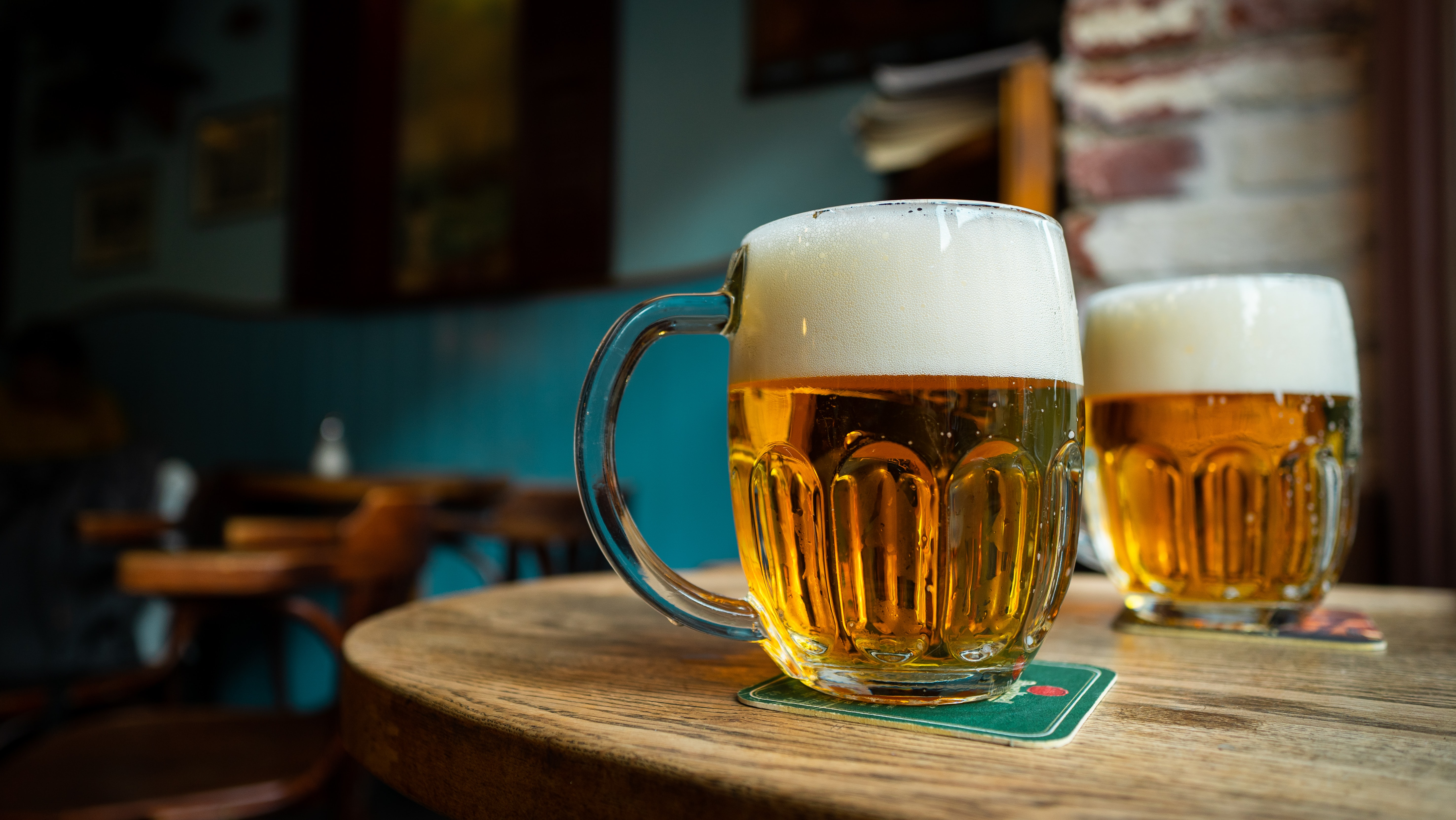 two mugs of beer on a table