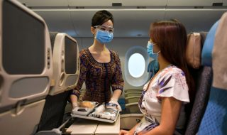 SIA stewardess with a passenger