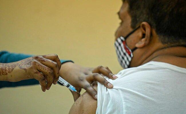 a man receiving an injection