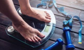 a person standing on a weighing scale