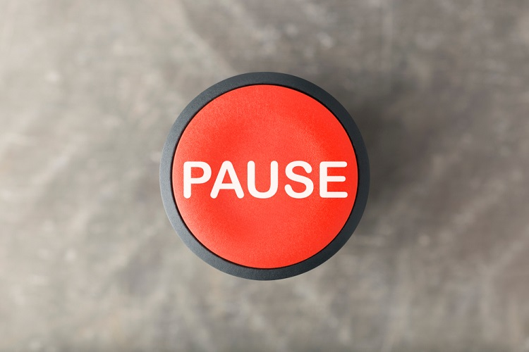 a red pause button