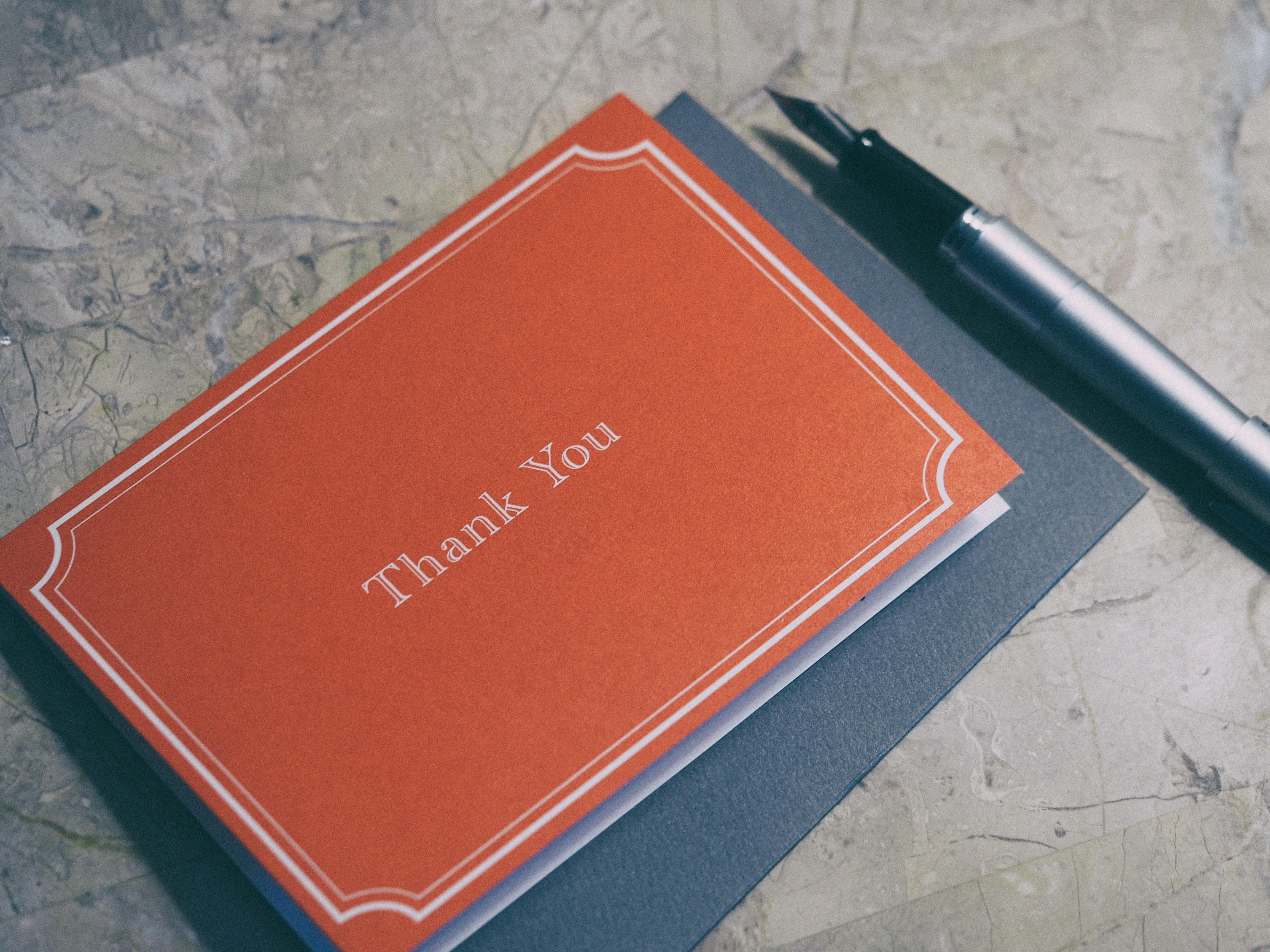 an orange thank you card