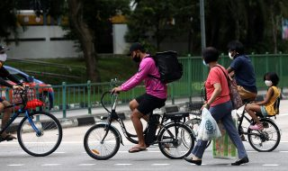 cyclists and pedestrians crossing the road