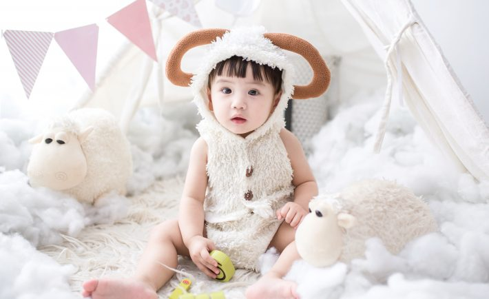 a child in a goat costume