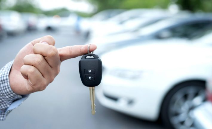 a man holding on to his car key